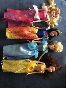 4  Disney Princesses Barbie dolls