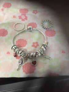 Authentic Pandora Bracelet, Clips, Charms, and Size 5(50) Rings