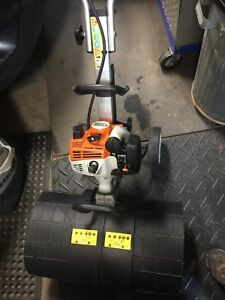 Stihl MM55 Yardboss with broom, tiller attachments, as new.