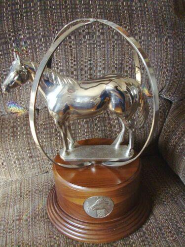 "AQHA World Globe horse trophy, 2010, 17"" x 12"" shiny silver color, nice"