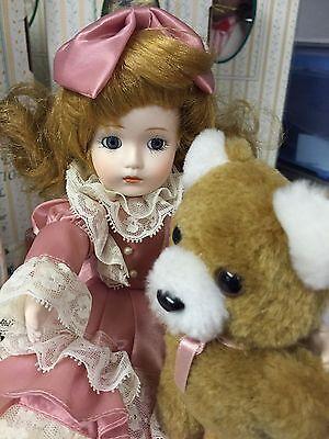 Seymour Mann Porcelain musical doll Brittany with teddy bear