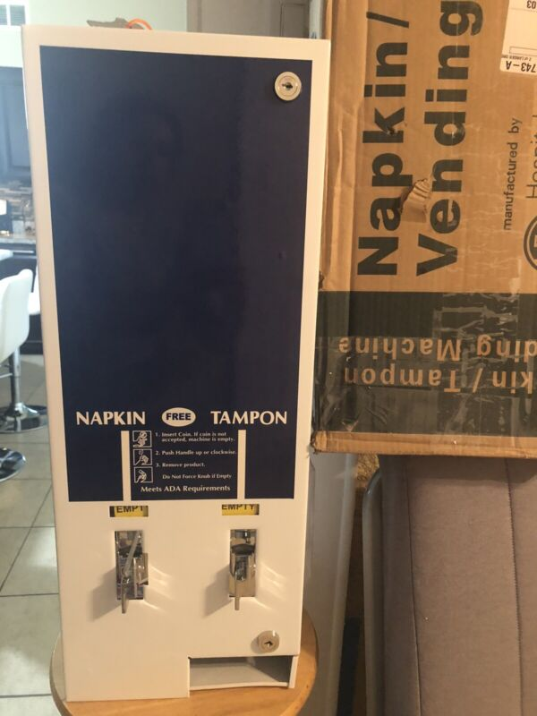 New Napkin/tampon Vending Machine.  Open Box Never Used