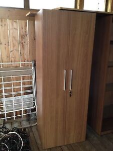 2 sided front and back shelving cupboard with the lock