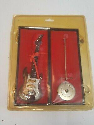 Guitarra electrica miniatura 18 cms con estuche y peana