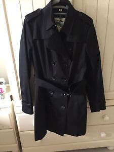 Authentic and brand new Burberry trench coat. Size XL
