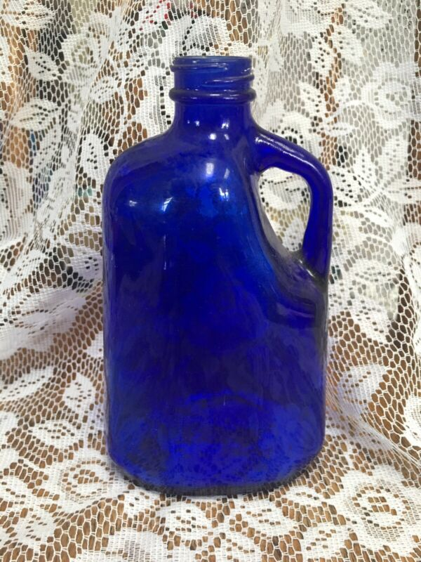 "Cobalt Blue Glass Bottle Jar 1 Handle Ribbing On Top 6"" X 3 1/2"" Wide."