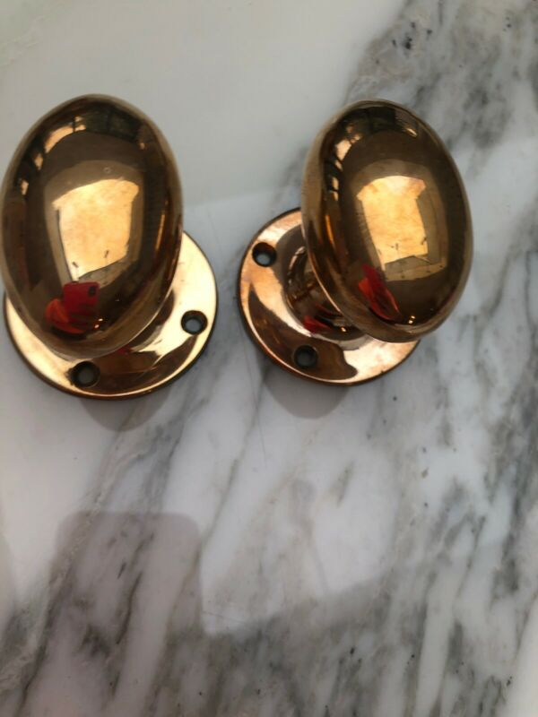 Pair Of Oval Goose Egg Brass Knobs