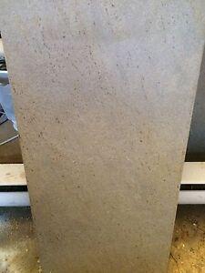 4 grey ceramic tiles