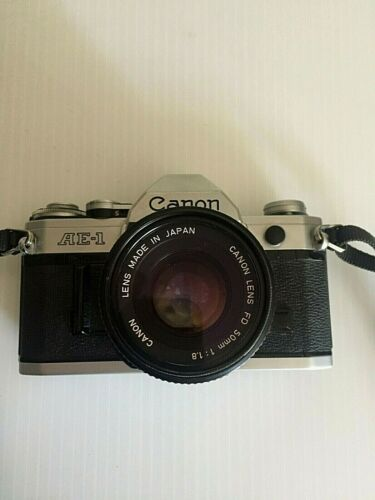 Canon AE-1, W/Lens, strap, flash, eye cup, lens filter / Used