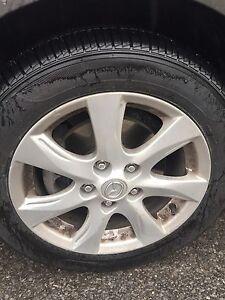 205/55r16 OEM Mazda 3 rims & new tires 450$ obo