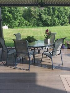 Circular patio table with six chairs for sale.