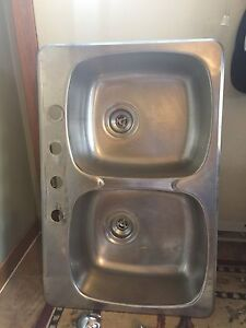 Stainless steel double sink and set of kitchen faucet