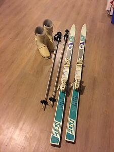 Ladies size 7 ski boots, poles and alpine skis