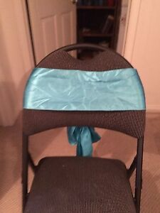 Teal chair sashes and fabric teal napkins
