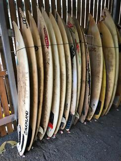 Surfboards suit shelves or pool seat