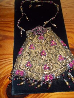 1920s Style Purses, Flapper Bags, Handbags 1920's beaded purse with rhinestone clasp $138.00 AT vintagedancer.com