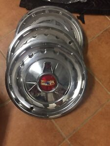 4 hubcaps from 57 bel air