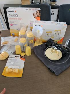 Medela Swing Breast Pump and Breast Milk Store & Feed Set