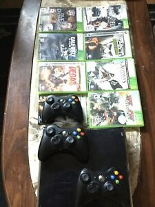 Xbox 360 Slim with 7 games and 3 controllers