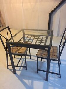 IKEA glass dining table with 2 chairs