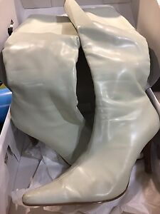 Ivory boots size 8.5