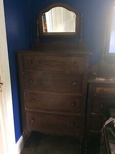 Antique tall dresser with mirror.