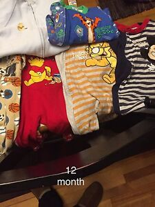6 pair of 12 month boys sleepers in great shape