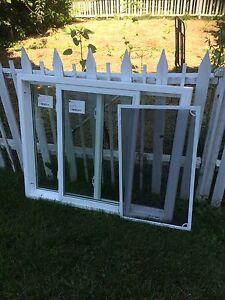 Two new white vinyl slider windows