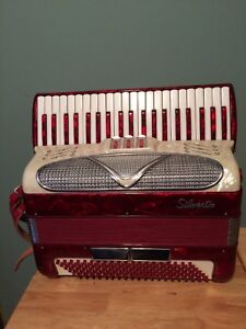 Silver tone piano accordian
