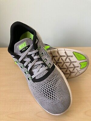 NIKE FREE RUN TRAINERS- MENS SIZE 9.5UK - GREY WITH LIME SWOOSH AND BLACK
