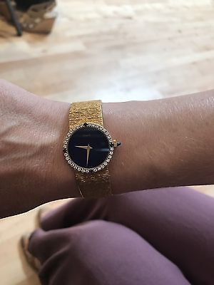 Piaget Ladies Watch Circa 1980's. Gold Band, Blue Lapis Face and Diamond Bezel.