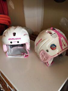 Children's adjustable ice skates and hockey helmets