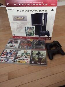 PlayStation 3 with 2 controllers and games