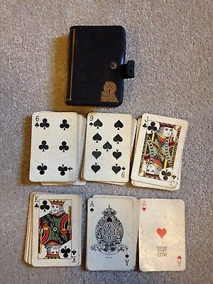 Art deco travelling playing cards in a blue leather cover