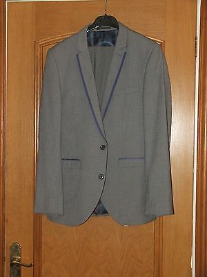 Mens or Youths two peice suit by Next with blue edging and dark blue shirt.