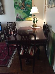 Chippendal dining table with  8 chairs on half prize