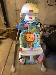 Baby swing rocker with mobile