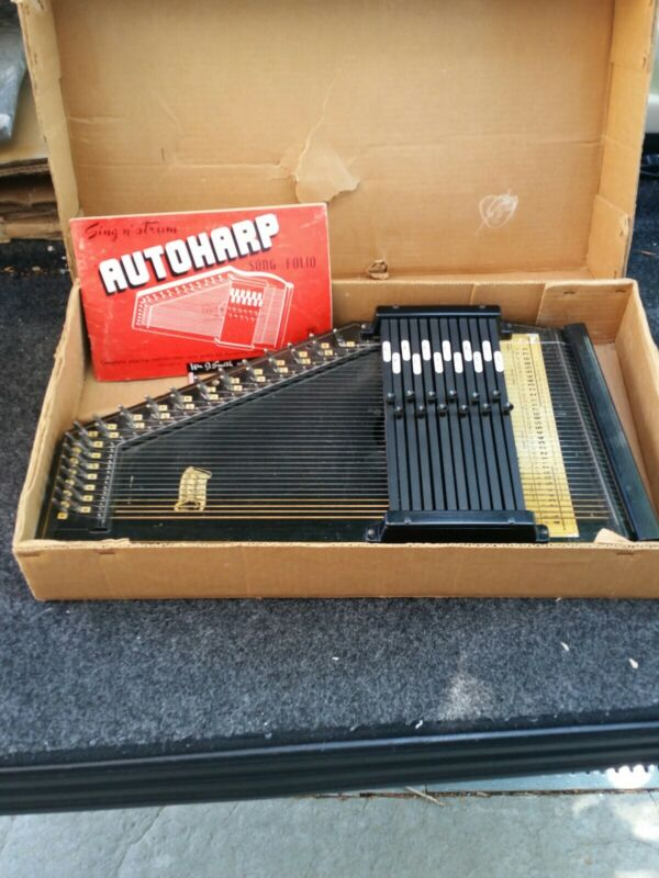 Antique Autoharp 1953 with original box and manual also has the tuner