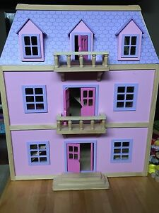 Wooden doll house with accessories
