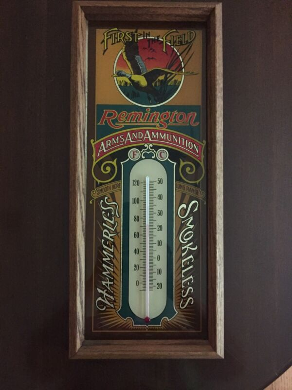 """Vintage First In The Field Remington Thermometer   Framed Very Nice 19"""" Tall"""