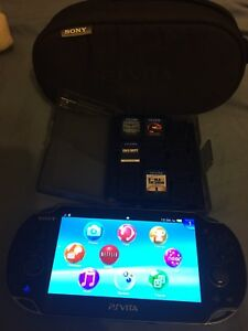 PlayStation Vita + 4 Games + Charger and carrying case