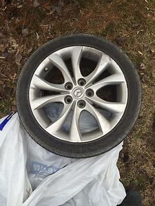 """Mazda 17"""" rims with tires"""