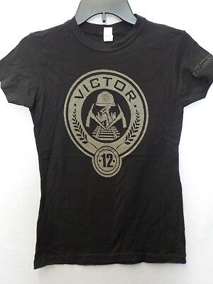Hunger Games Woman (JUNIORS WOMENS THE HUNGER GAMES CATCHING FIRE DISTRICT 12 VICTOR TSHIRT)