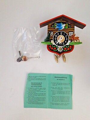 "German Pendulum movement with Key Cuckoo Clock Wood Plastic 4"" x 4.5"" Vintage"