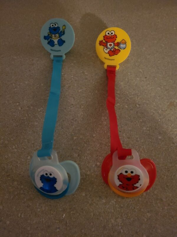 2  Magnetic pacifiers w/ holders