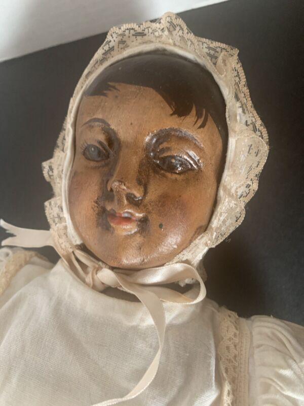 Vintage wooden carved doll