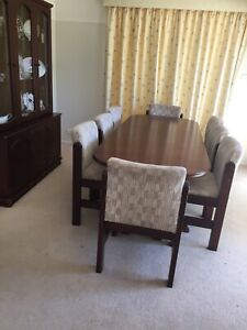 8 seater extendable table, dark wood, with 8 chairs.