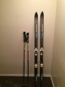 Pair of down hill skis and poles