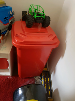 red wheeliebin toybox