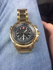 Gold Swiss army watch
